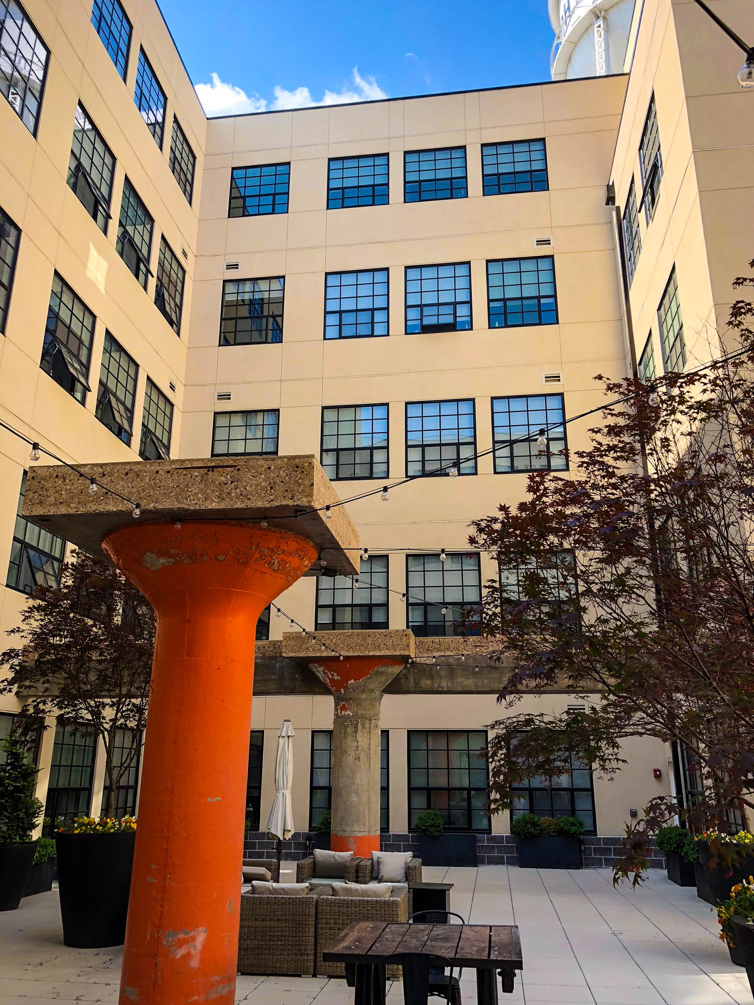 Hect Warehouse - Right side view of office building with orange pillars