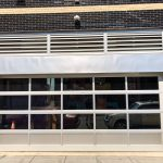 Hect Warehouse - Office building with garage door style windows